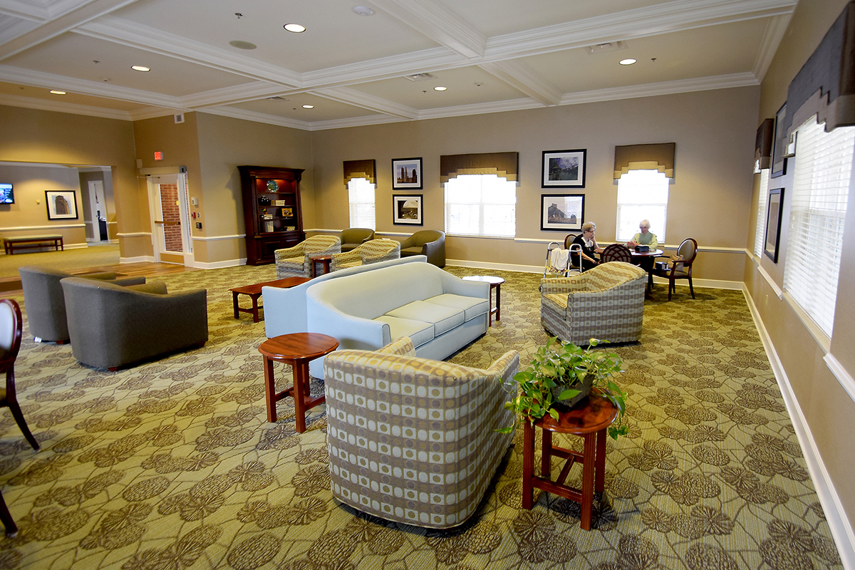 Spacious Front Lobby with Residents Socializing